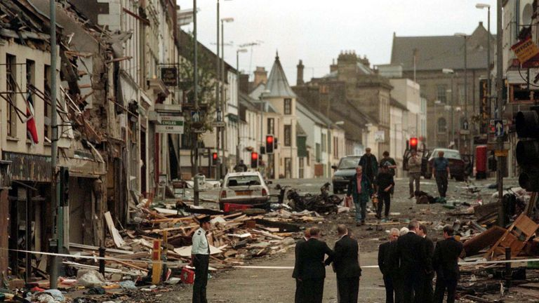 Police standing in the rubble after a car-bomb ripped through Omagh