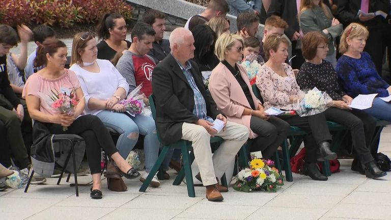 Victims' families sat together in the memorial gardens
