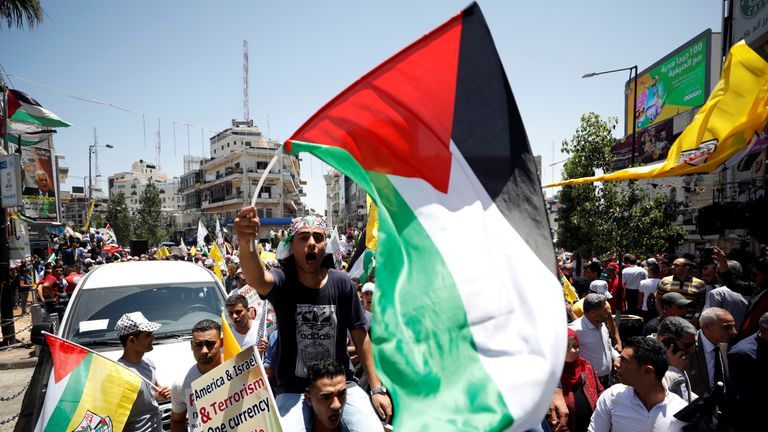Palestinians protest against against the US and Israel in Ramallah