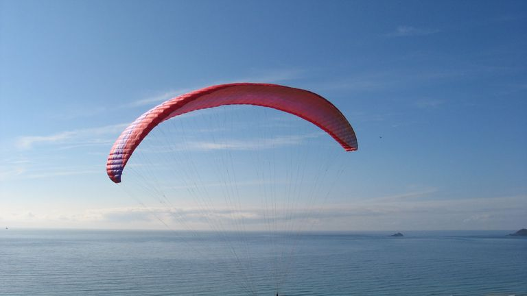 Abusive and hostile' low-flying paraglider sought by police in