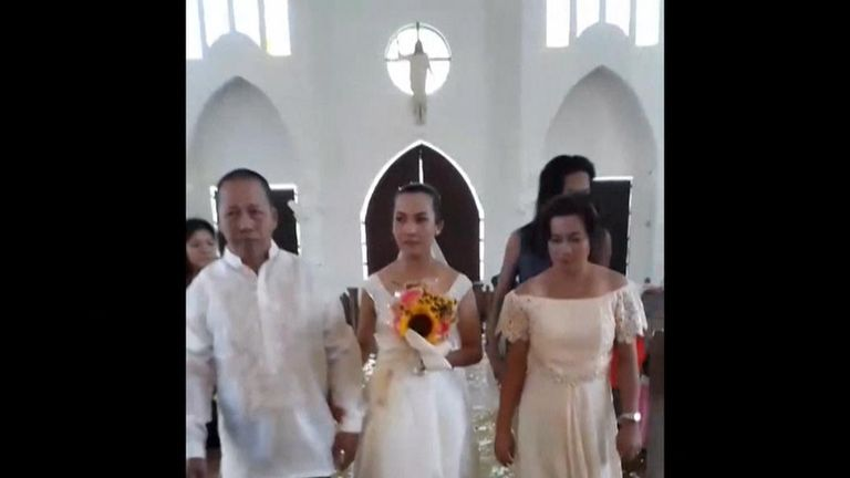 A couple decided to push through with their wedding, despite a flooded church.  The bride and her parents waded down the flooded aisle through murky water up to the barefoot groom who was waiting by the altar.