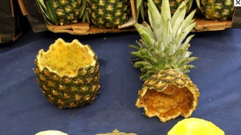 The 67kg haul was found inside dozens of hollowed-out pineapples. Pic: Policia Nacional