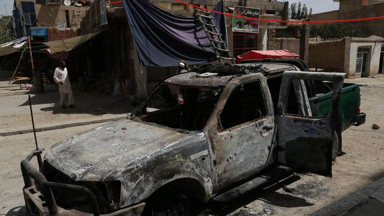 A burnt police vehicle after a Taliban attack in Ghazni