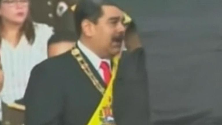 President Maduro of Venezuela is protected by security after an attempt on his life during a live TV broadcast
