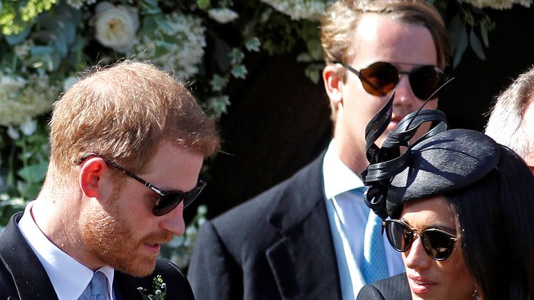 Prince Harry was seen holding Meghan's hand at the church