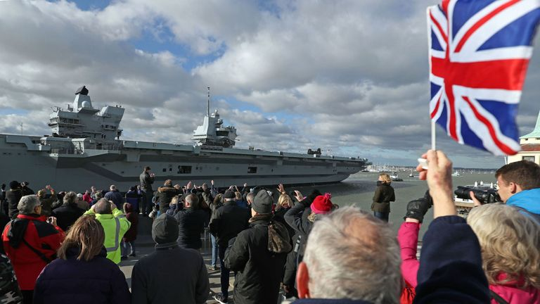 HMS Queen Elizabeth leaves Portsmouth Harbour in Hampshire to begin the next leg of her sea trials