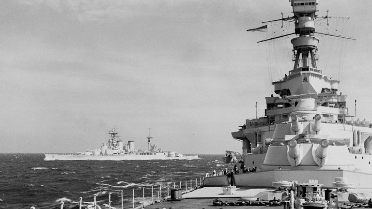 The Royal Navy Admiral-class battlecruiser HMS Hood as viewed from the forcastle of the Renown-class battlecruiser HMS Repulse and her 42-calibre BL 15-inch Mk I guns from the forward A and B turrets whilst on patrol in the North Sea on 1 September 1939