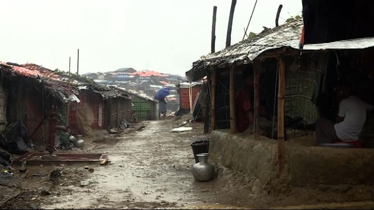 An estimated 6,000 Rohingya Muslims are stranded in a flooded camp in 'no man's land'