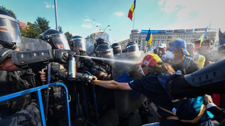 Romanian police scuffle with protesters and spray tear gas