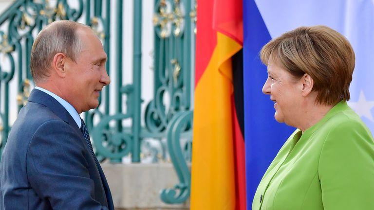 Angela Merkel welcomes Vladimir Putin to Schloss Meseberg castle for talks