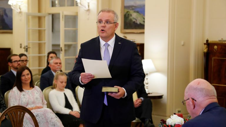 Scott Morrison attends a swearing-in ceremony to become new prime minister