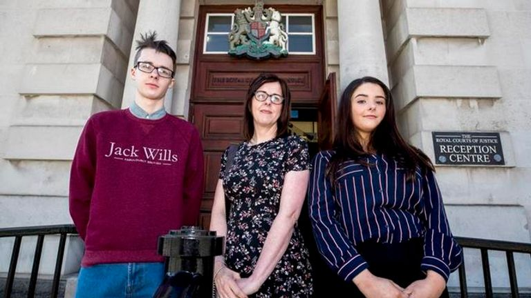 Siobhan McLaughlin (centre) and her children Billy and Rebecca Adams, at the Royal Courts of Justice in Belfast