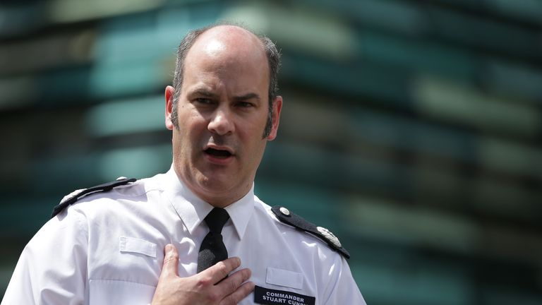 London Police Commander Stuart Cundy makes a statement to the media against the backdrop of the remains of Grenfell Tower, a residential tower block in west London which was gutted by fire, in west London on June 16, 2017. The toll from the London tower block fire has risen to at least 30 people dead and the flames have now been extinguished, police said on June 16, 2017. / AFP PHOTO / Daniel LEAL-OLIVAS (Photo credit should read DANIEL LEAL-OLIVAS/AFP/Getty Images)