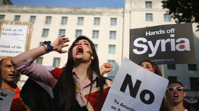 Protesters pictured campaigning against military intervention in Syria in 2013