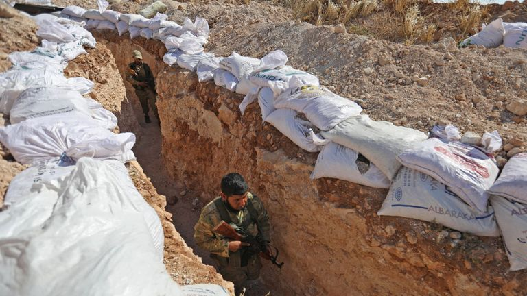 Rebel forces have built trenches in preparation for a government offensive