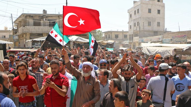 Protesters in rebel-held areas rallied against state action