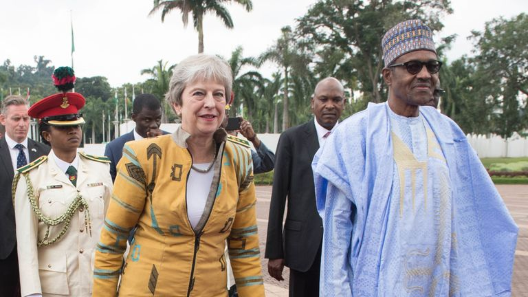 Prime Minister Theresa May is greeted by Nigerian President Muhammadu Buhari at the presidential villa in Abuja, Nigeria