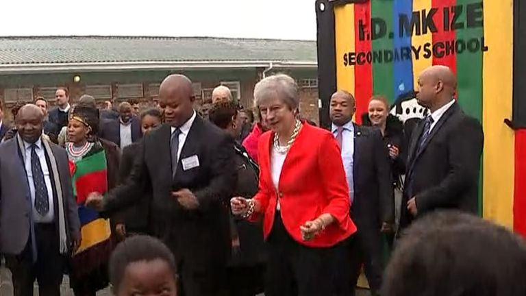 Theresa May joined in with the welcoming committee in Cape Town and danced  along to the music