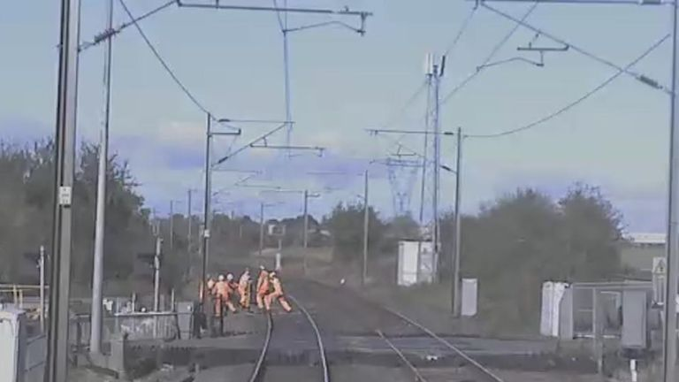 Line workers jump clear at the last second from a train approaching at 125mph