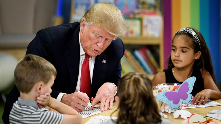 U.S. President Donald Trump speaks with children while visiting Nationwide Children's Hospital in Columbus...