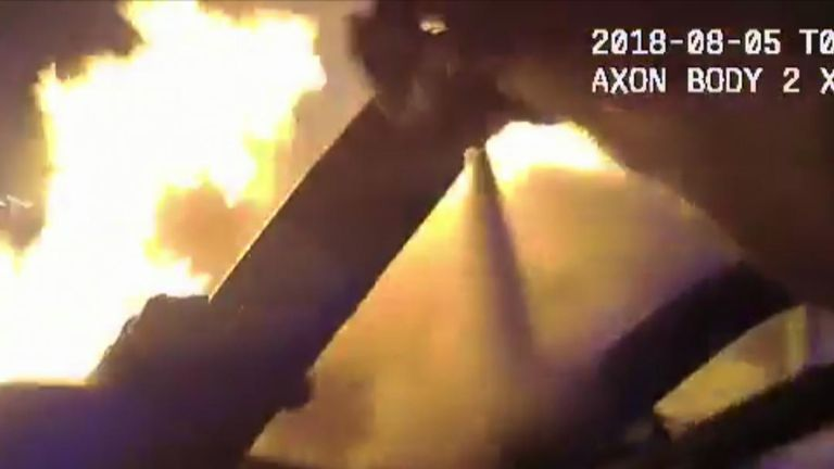 Dramatic body cam video shows Atlanta police officers rescuing a man from a burning car