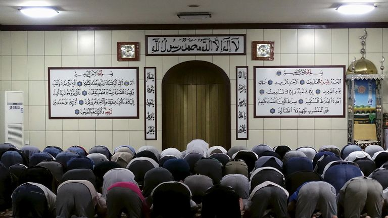 Muslims pray at a mosque during Ramadan in Urumqi, Xinjiang