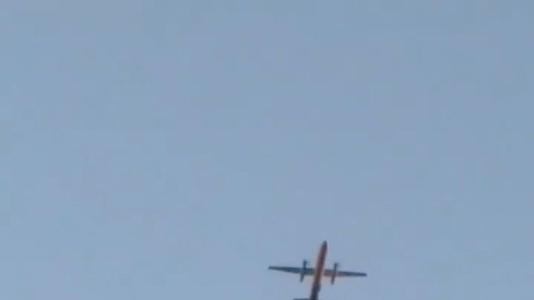 A Horizon Air Bombardier Dash 8 Q400, reported to be hijacked, flies over Fircrest, Washington, the U.S