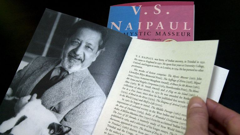 """A person displays a book with the title """"Mystic masseur"""" written by V.S. Naipaul at the Frankfurt book fair October 11, 2001."""
