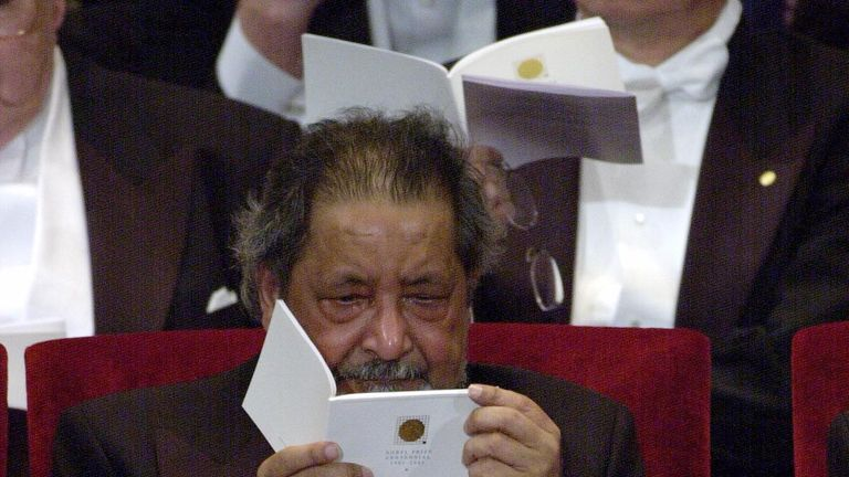Sir V. S. Naipaul cries after recieving the Nobel Prize from King Carl Gustaf of Sweden at the Prize Award Ceremony at the Concert Hall in Stockholm December 10, 2001
