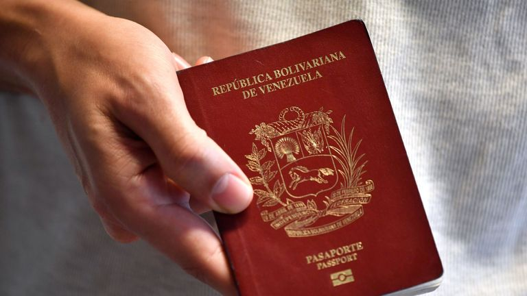 A Venezuelan citizen shows his passport in Montevideo