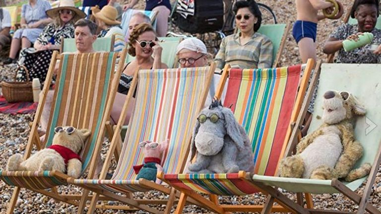 Pooh, Piglet, Eeyore and Tigger catch some rays on the beach