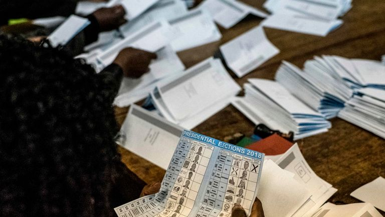 Election officials tally presidential candidates' ballots during counting