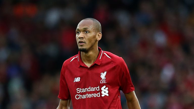 Liverpool's Fabinho says he is adapting to life in England and is improving under the guidance of Jurgen Klopp