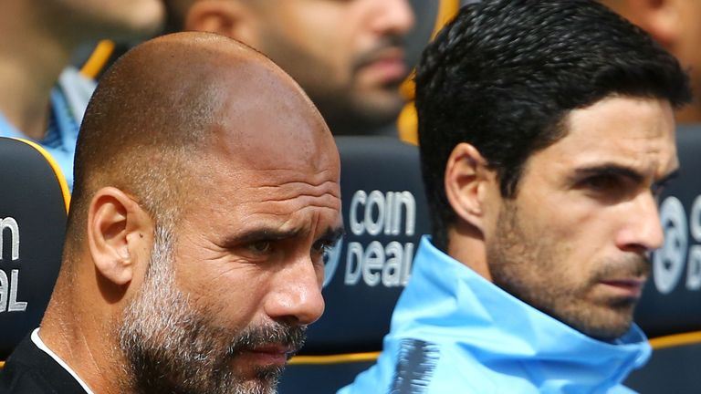 Pep Guardiola and assistant coach Mikel Arteta in the dug out before kick-off