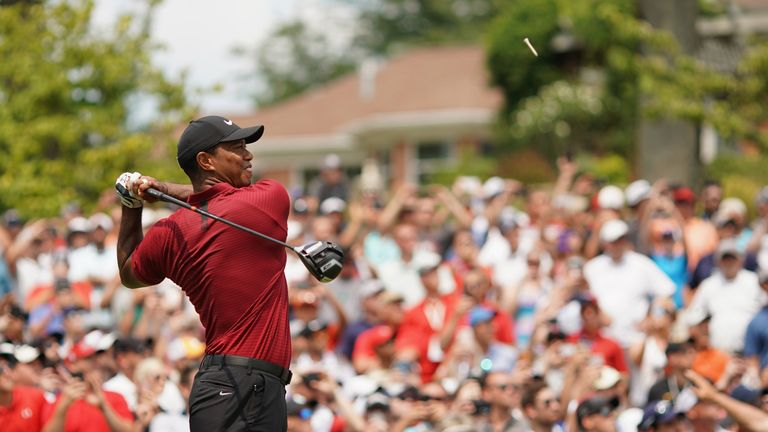 Tiger Woods hangs in there at the turn in the PGA Championship