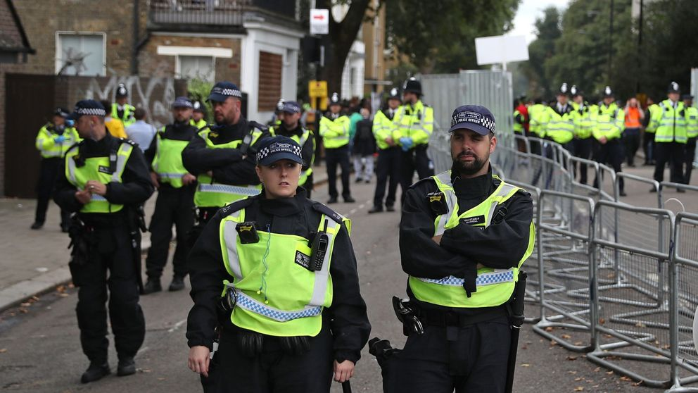 Police officers stand guard on a side-street on the main Parade day of the Notting Hill Carnival in west London on August 27, 2018. - Nearly one million people are expected by the organizers Sunday and Monday in the streets of west London's Notting Hill to celebrate Caribbean culture at a carnival considered the largest street demonstration in Europe. (Photo by Daniel LEAL-OLIVAS / AFP) (Photo credit should read DANIEL LEAL-OLIVAS/AFP/Getty Images)