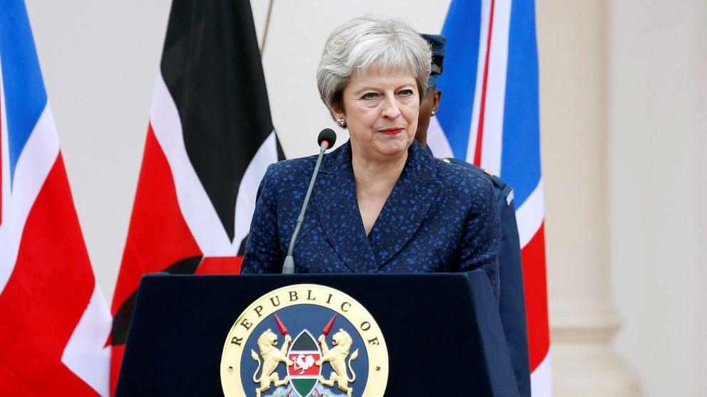 Theresa May addresses a joint news conference with Kenya's President Uhuru Kenyatta at the State House in Nairobi, Kenya