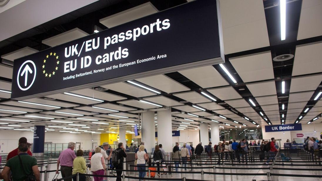 LONDON, ENGLAND - MAY 28: Border Force check the passports of passengers arriving at Gatwick Airport on May 28, 2014 in London, England. Border Force is the law enforcement command within the Home Office responsible for the security of the UK border by enforcing immigration and customs controls on people and goods entering the UK. Border Force officers work at 140 sea and airports across the UK and overseas. (Photo by Oli Scarff/Getty Images)