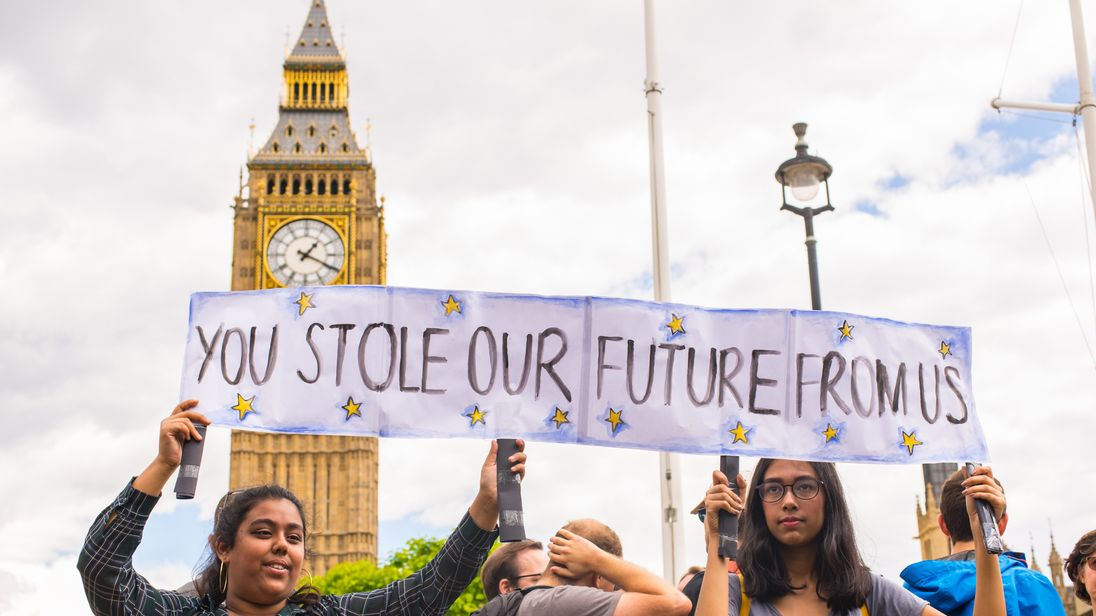 """Westminster, London, UK - 25 June 2016: Young female pro-remain protesters carrying poster saying """"You stole our future from us"""" as part of protests against Brexit in front of the House of Parliament in London, UK."""