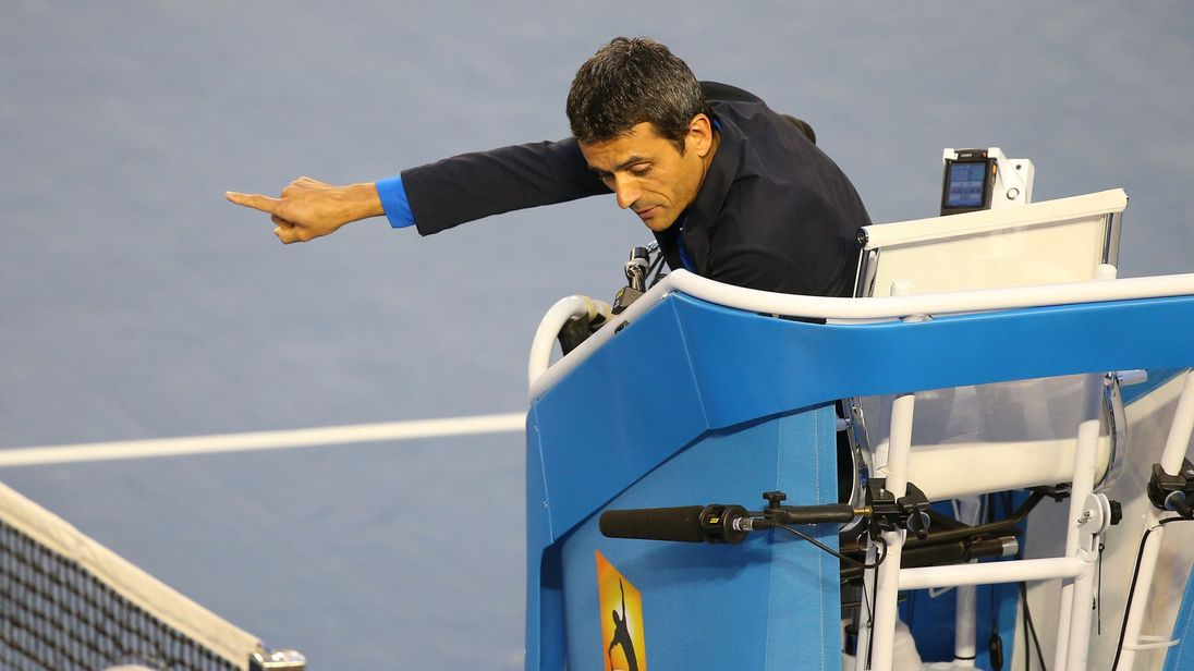 MELBOURNE, AUSTRALIA - JANUARY 26: Chair umpire Carlos Ramos speaks to Stanislas Wawrinka of Switzerland whilst Rafael Nadal of Spain leaves the court during day 14 of the 2014 Australian Open at Melbourne Park on January 26, 2014 in Melbourne, Australia. (Photo by Mark Kolbe/Getty Images)