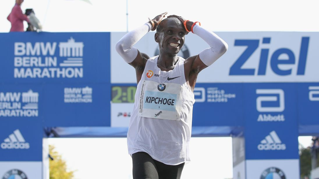 Eliud Kipchoge of Kenya crosses the finishing line to win the Berlin Marathon 2018 in a new world record time