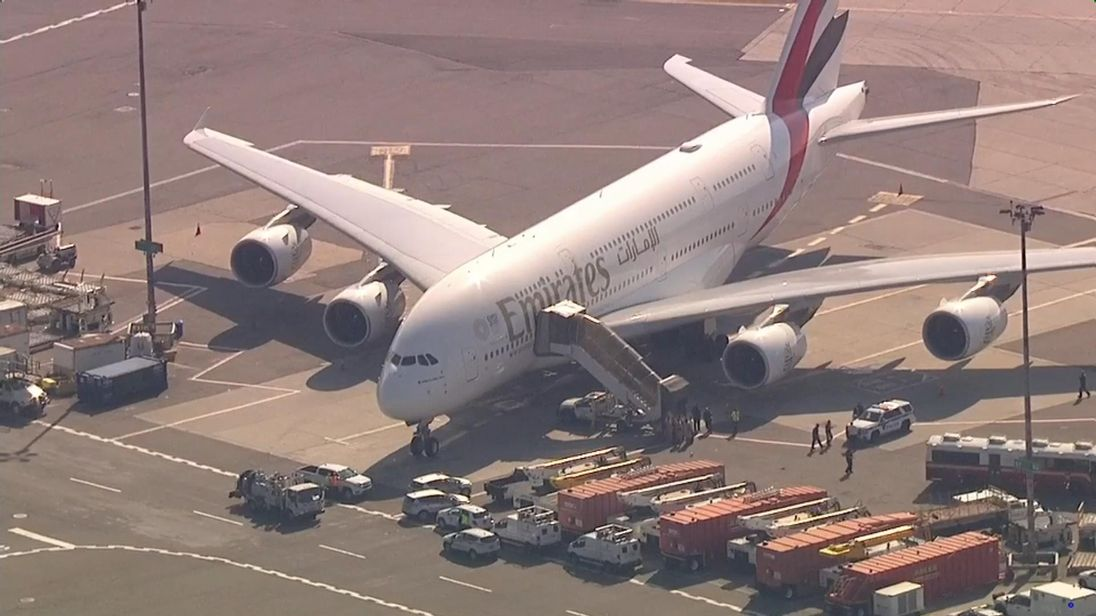 Emirates jet met by ambulances and disease experts at JFK after passengers fall ill