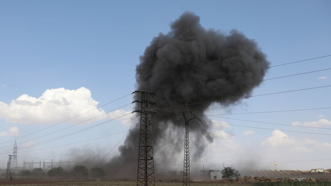 Smoke billows from Syian government bombing around the village of al-Muntar