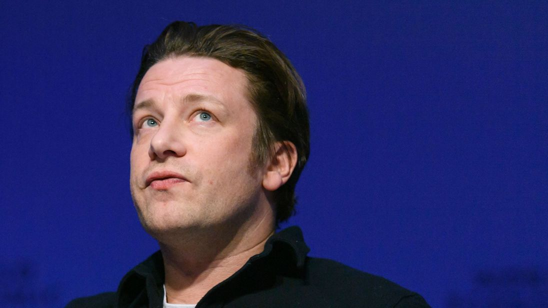 Jamie Oliver 'tackles and pins burglar to ground' outside his house
