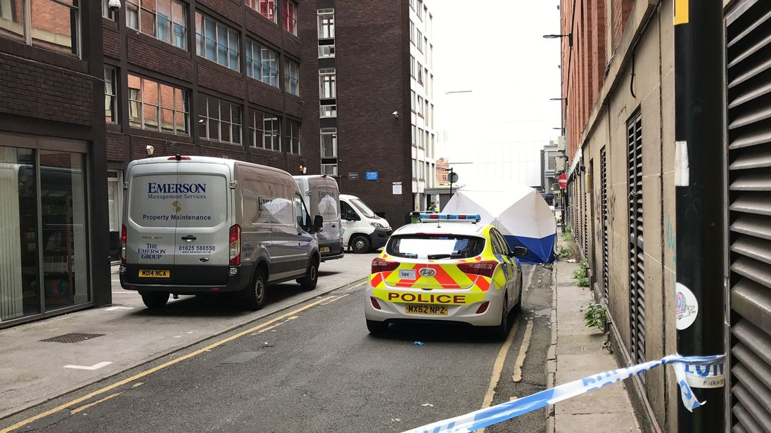 A police forensic tent outside the Britannia Hotel in Manchester city centre, where two men have been found dead