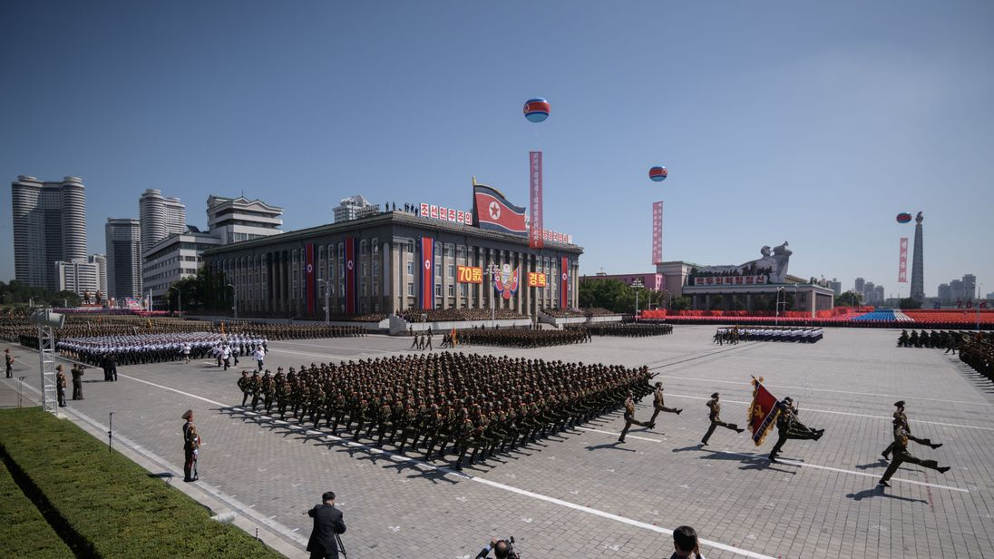 Korean People's Army soldiers march during a military parade and mass rally on Kim Il Sung square in Pyongyang