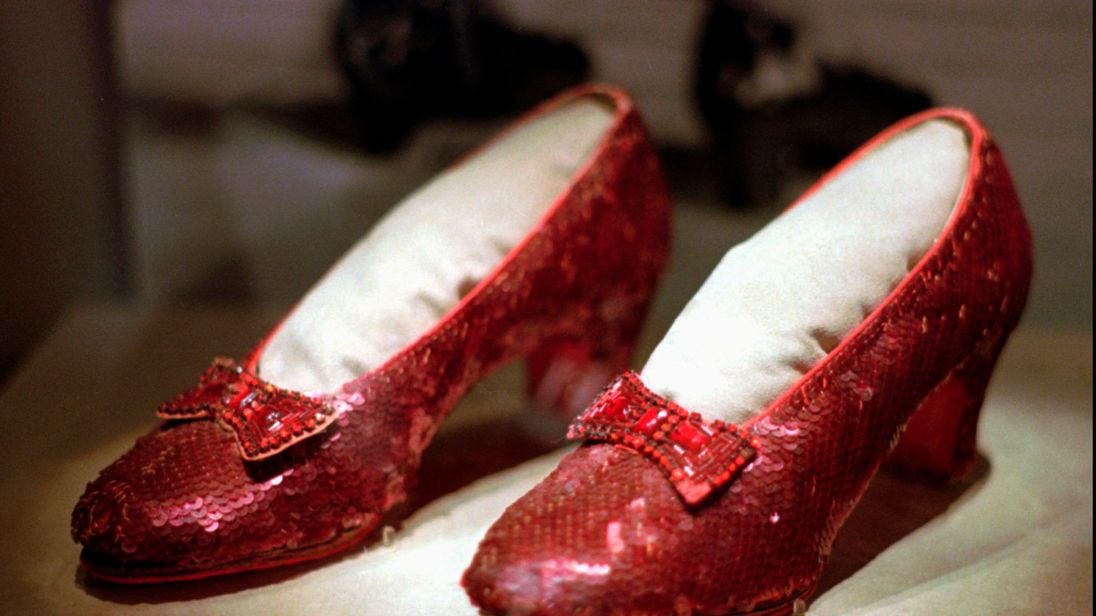 "1996 file photo shows one of the four pairs of ruby slippers worn by Judy Garland in the 1939 film ""The Wizard of Oz"""