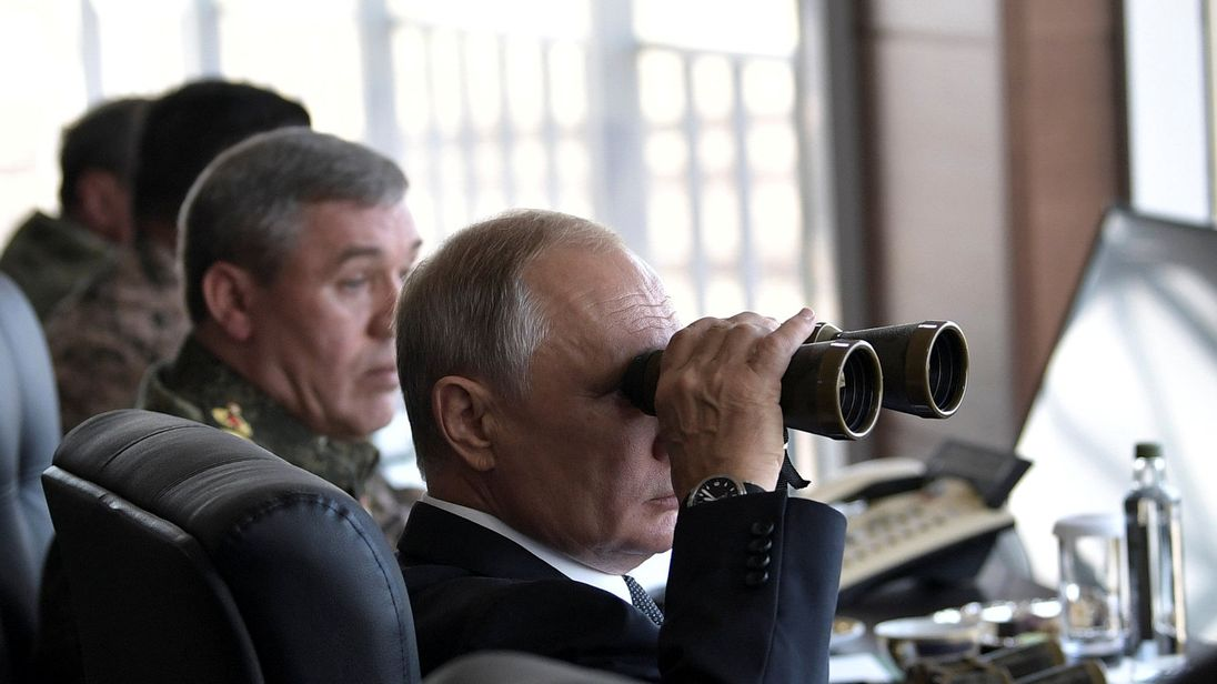 Russian President Vladimir Putin uses a pair of binoculars as he watches the Vostok-2018 (East-2018) war games