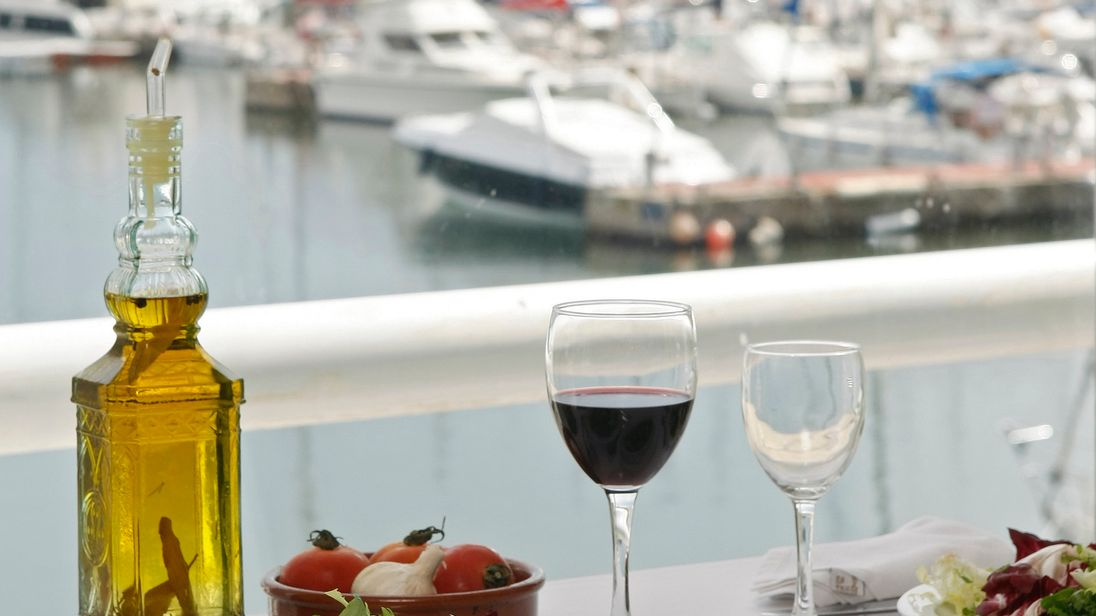 Food is seen on a table at a restaurant at the port of El Masnou, near Barcelona