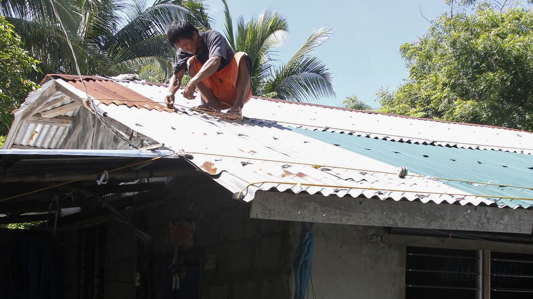 People have been storm-proofing their houses ahead of the typhoon's arrival